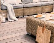 Wicker patio set on a deck in a backyard
